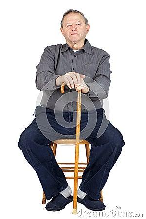 Senior man with cane sitting