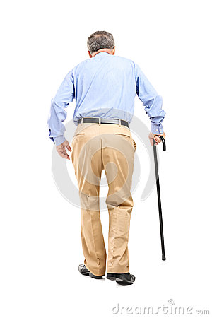Senior man with cane walking