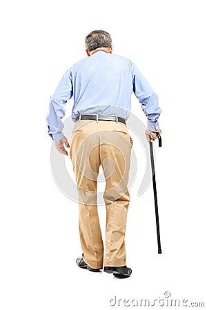 Senior man with cane walking