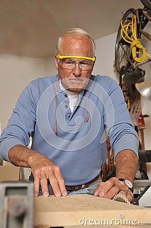 Free Senior Man Carpenter Working With Wood Stock Photography - 20677262