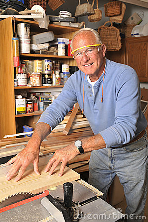 Free Senior Man Carpenter Working With Wood Stock Photography - 20677282