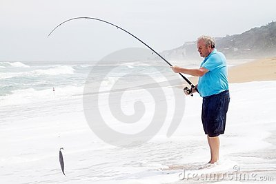 Senior man catching fish