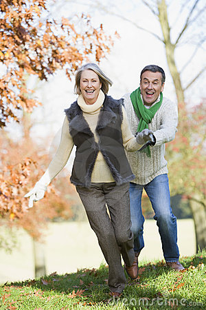 Free Senior Man Chasing Woman Through Countryside Stock Photo - 5307910
