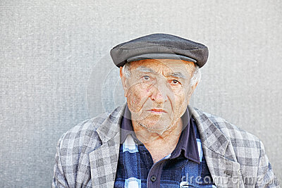 Senior man in checkered jacket and cap