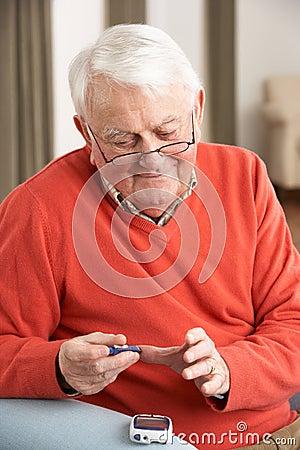 Senior Man Checking Blood Sugar Level