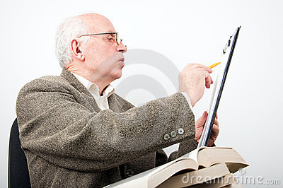 Senior man checking data on clipboard