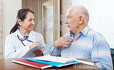 senior men complaining to friendly doctor about malaise in interior
