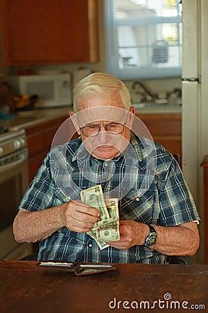 Senior man counting money