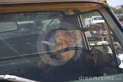 Senior Man With Cowboy Hat Driving Pickup