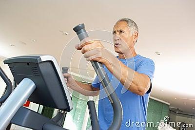 Senior Man On Cross Trainer