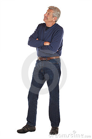 Senior man crosses arms and looks up