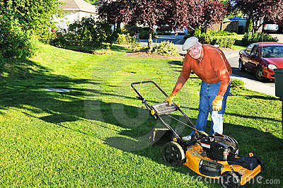 Senior Man Cutting Grass