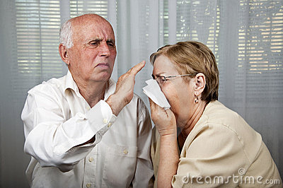 Senior man dodge sick women sneezing