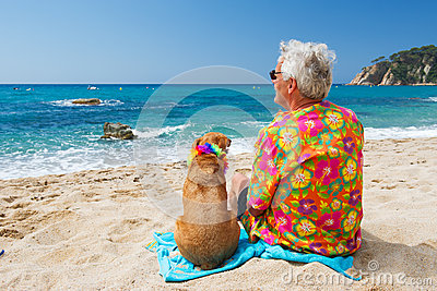 Senior man with dog on beach