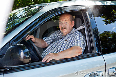 Senior man driving a car