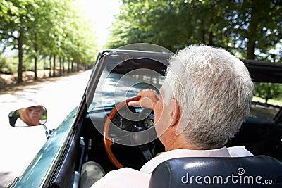 Senior man driving sports car