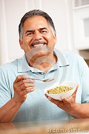 Senior man eating cereal