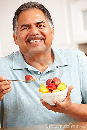 Senior man eating fruit