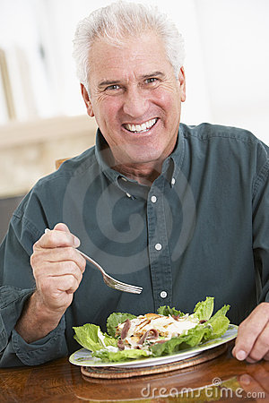 Senior Man Eating A Healthy Meal