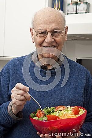 Senior man eating a healthy salad