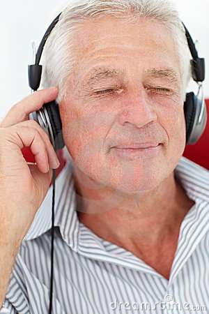 Senior man enjoying music