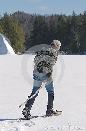 Senior Man Exercising on Lake