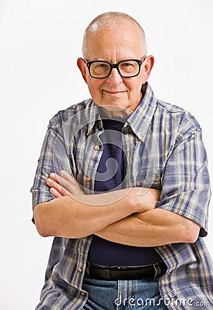 Senior man in eyeglasses with arms crossed