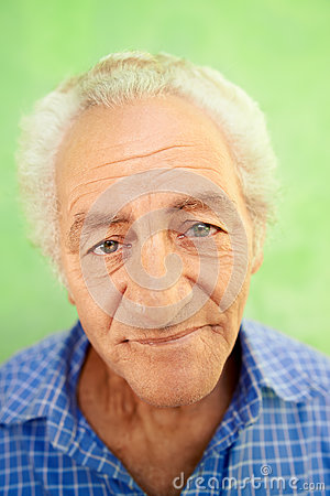 Portrait of happy elderly caucasian man smiling at camera