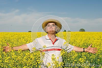 Senior man in a field of rape