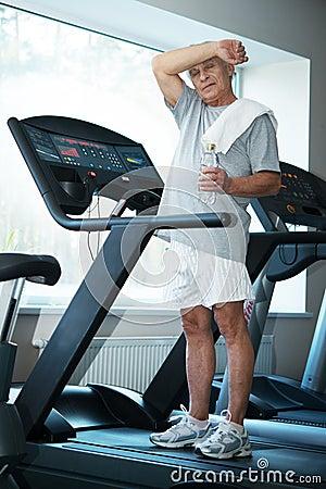 Senior man in a fitness club
