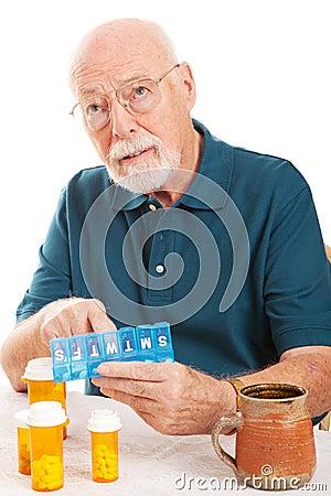 Free Senior Man Forgot To Take Medicine Stock Photos - 25396893