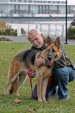 Senior Man and German Sheperd Dog