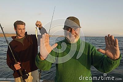 Senior Man Gesturing On Yacht