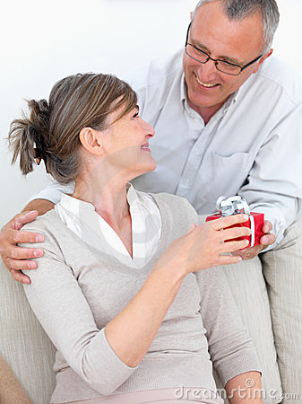 Senior Man Giving Gift To His Wife Stock Photos - Image: 7456903