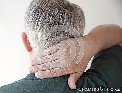 Senior man with hand on neck