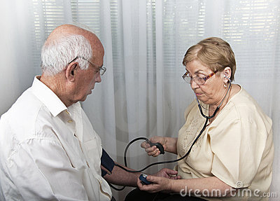 Senior people blood pressure check