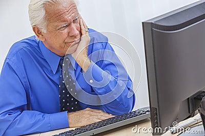 Senior Man Having Trouble Using Computer