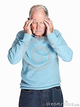 Senior man with headache holding his head