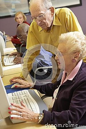 Free Senior Man Helping Senior Woman To Use Computer Stock Photography - 9004072