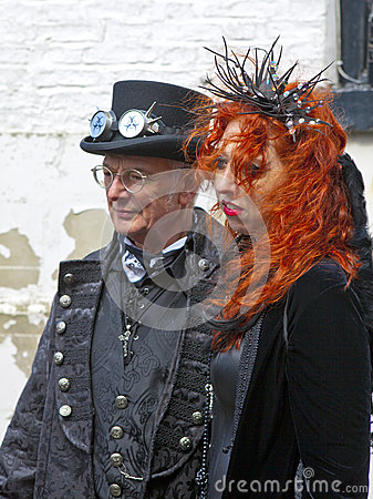 Senior man with his daughter in Gothic attire. Editorial Photography