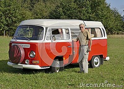 Senior man with his retro car