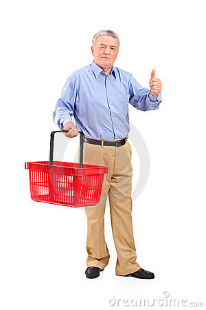 Senior man holding basket and giving thumb up