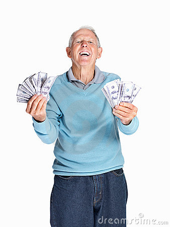 Senior man holding dollars