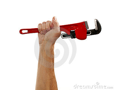 Senior man holding a large wrench