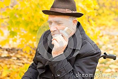 Senior man holding a mobile phone