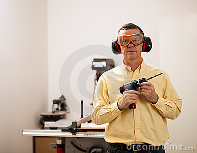 Senior man holding power drill