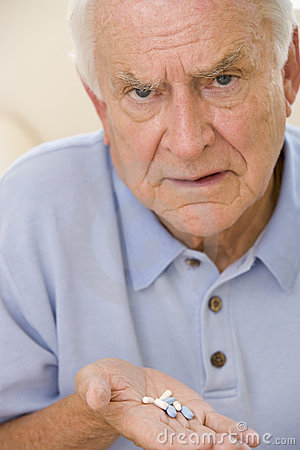 Senior Man Holding Prescription Drugs