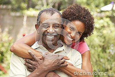 Senior Man Hugging Adult Daughter