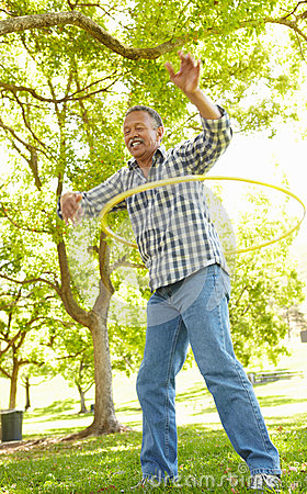 Senior man with hula-hoop