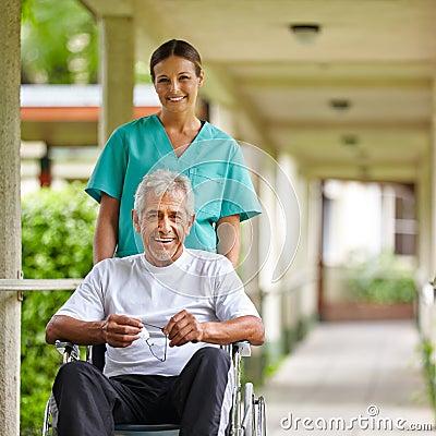 Free Senior Man In Wheelchair With Nurse Stock Image - 29057341